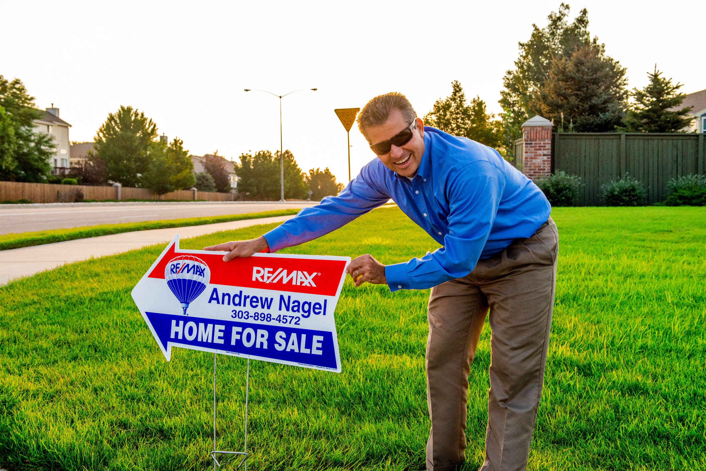 Andrew Nagel putting out Remax directional signs.