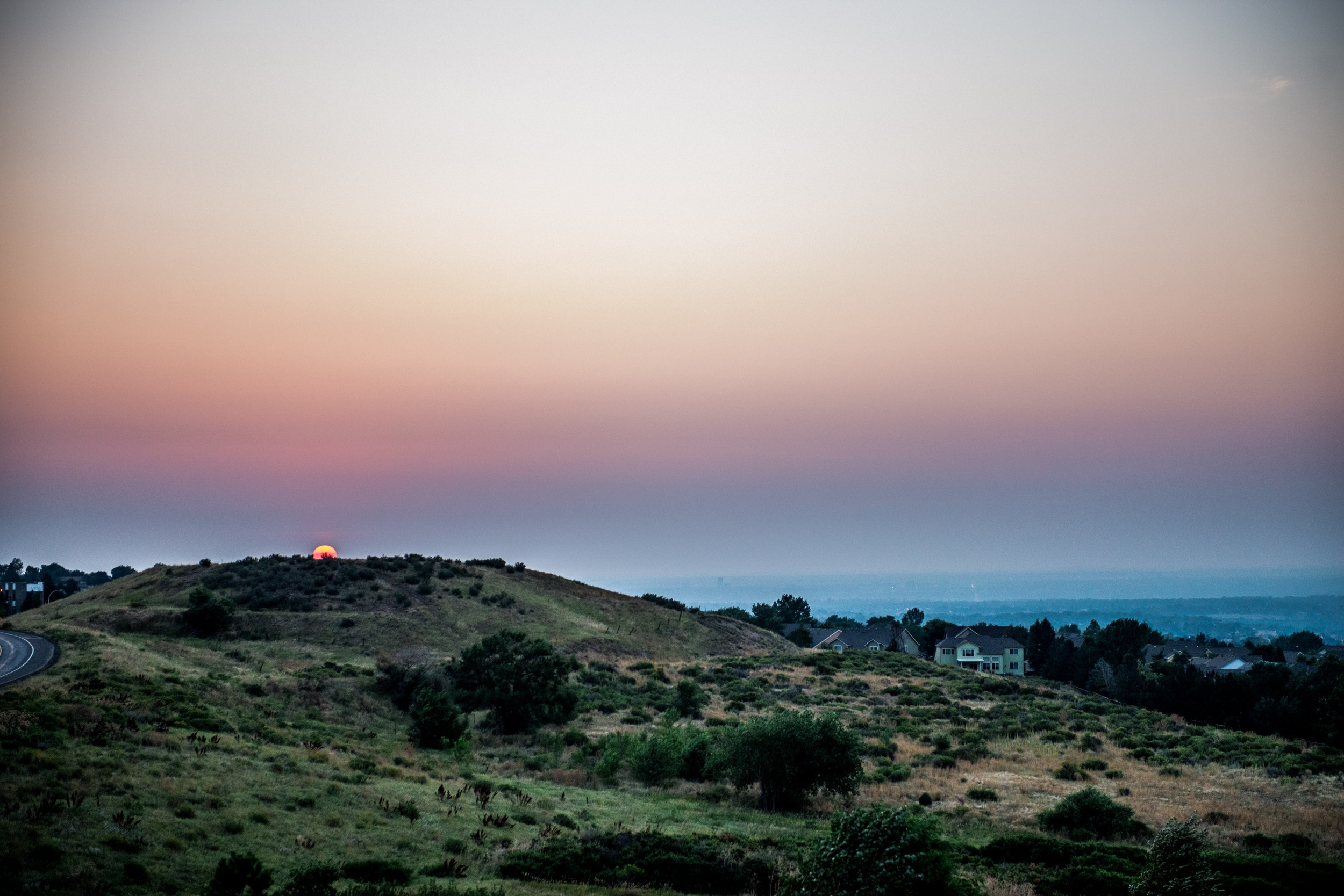 Sunset comes to the foothills of Solterra in Lakewood, CO