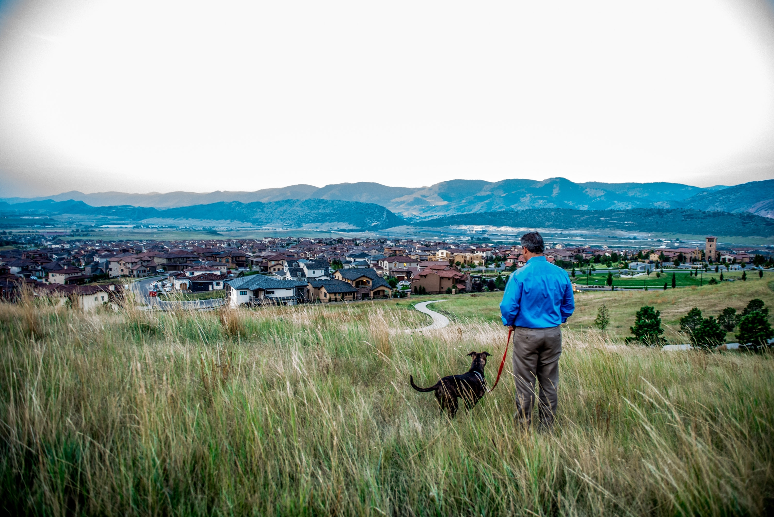 Andrew and his dog on the rim of Solterra, a foothills community in Lakewood, CO