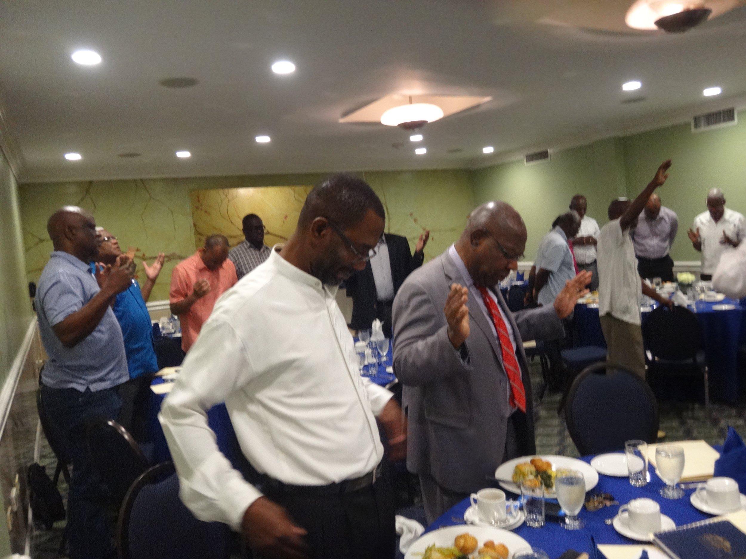 Pre-Congress participant praying