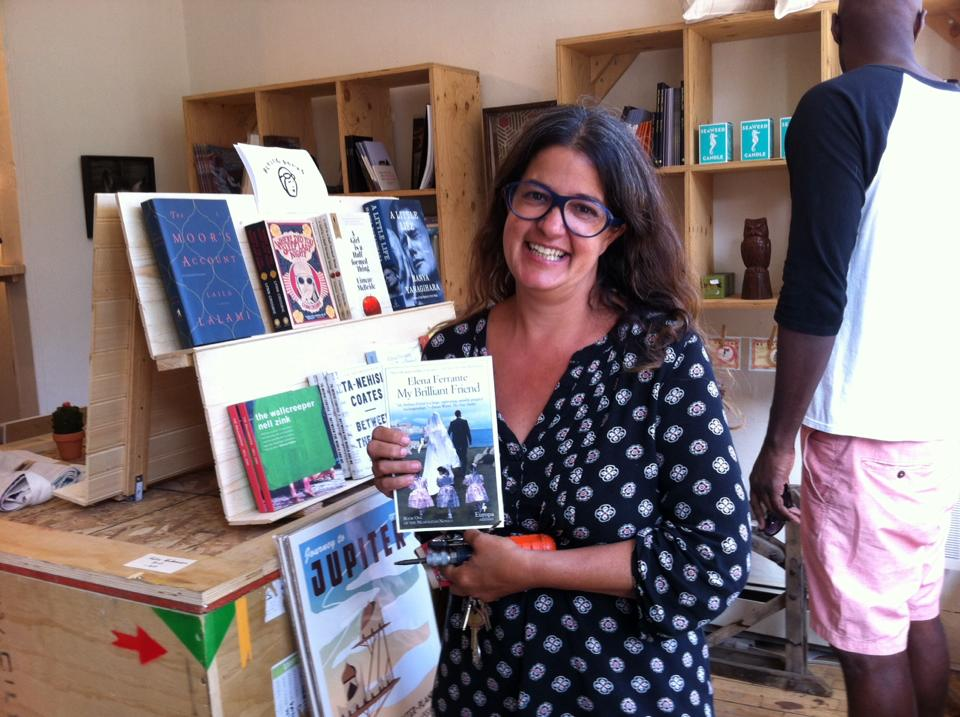 Katharine Mulherin, buying the very first book Flying Books sold, a copy of  My Brilliant Friend.