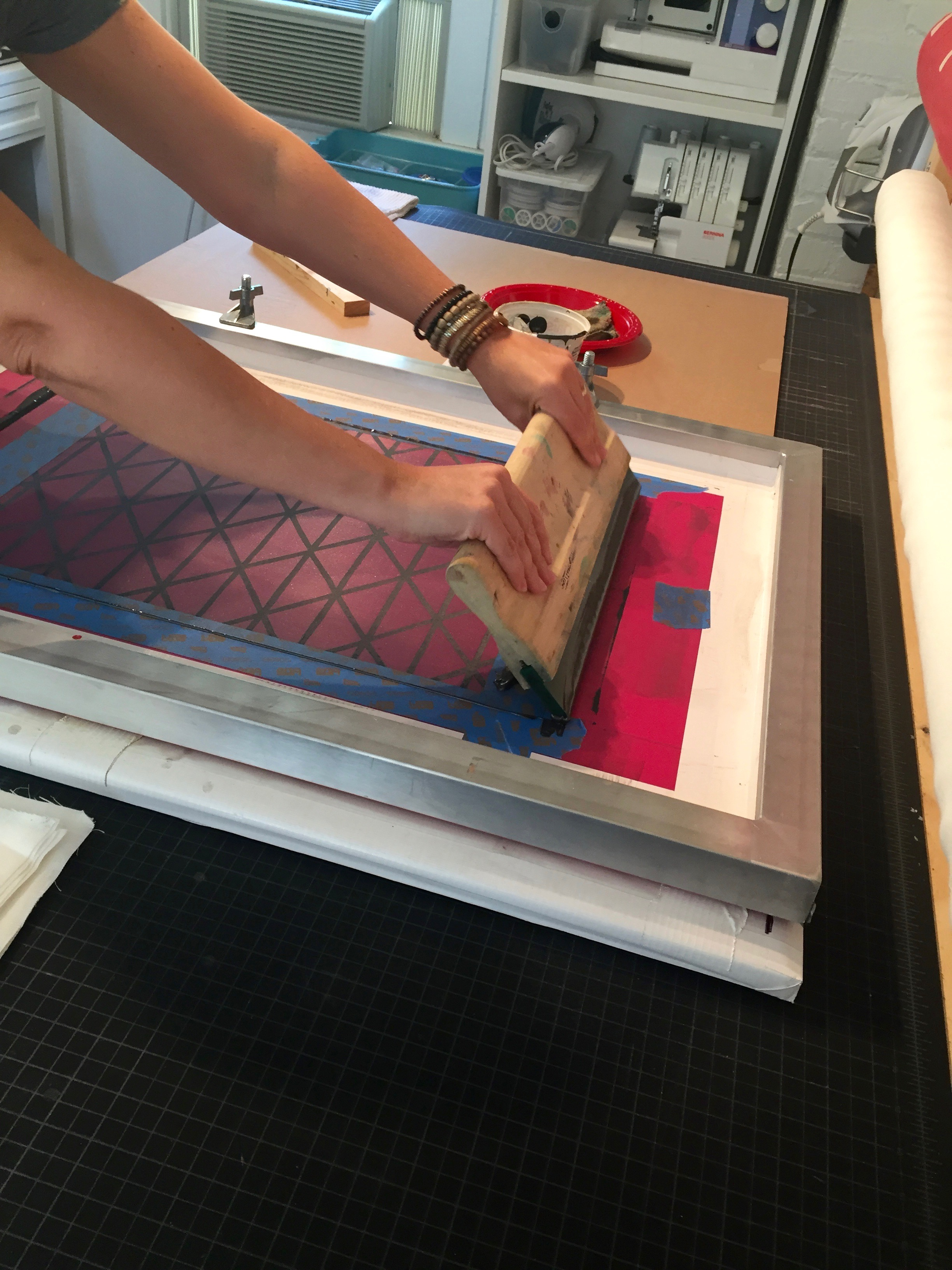 Working the ink through and pressing into the fabric