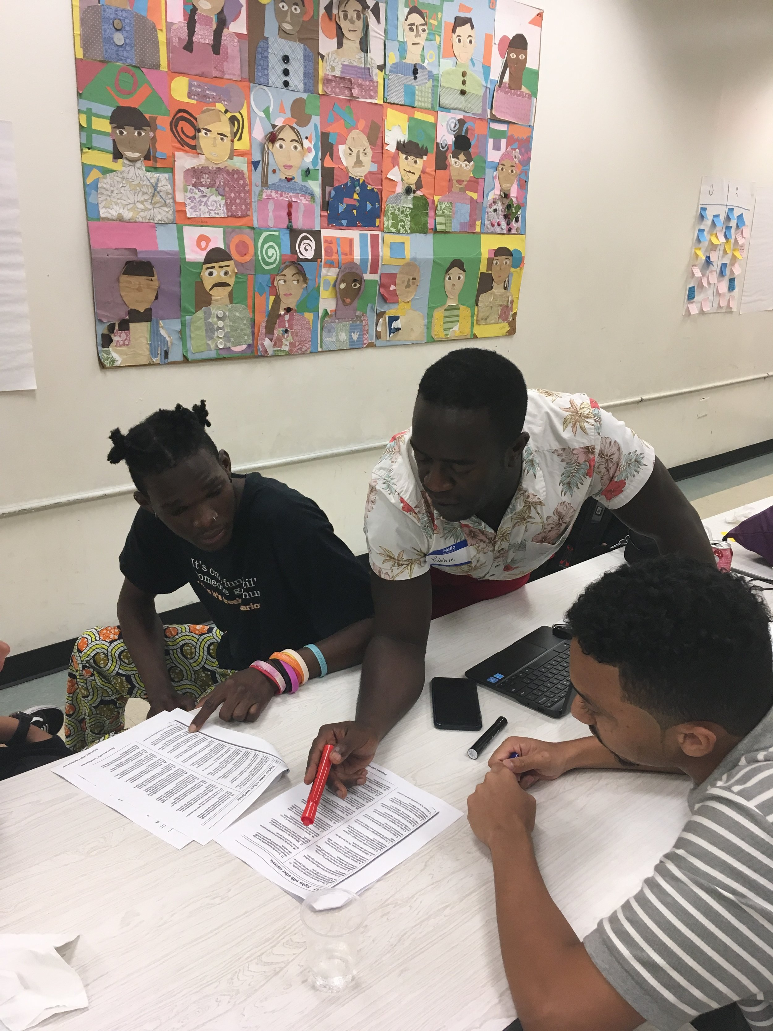Youth workers discuss positive behavior strategies in a summer training institute in Harlem run by Voices Advance.