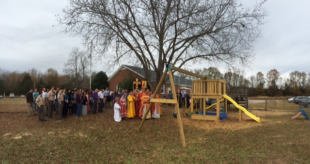Everyone gathered after liturgy to bless the playground.