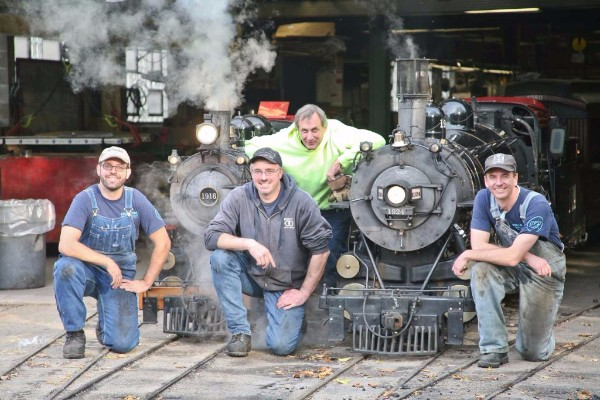 Members of the CSR / Zoo research team pose in front of the two steam locomotives operated by the Zoo.  • People, from left to right: Davidson Ward [CSR]; Ken Ristow [Zoo]; Rob Mangels [CSR]; and Wolf Fengler [CSR]. • Locomotives, from left to right: 4-4-2 No. 1916, burning coal; and 4-6-2 No. 1924, burning torrefied biomass - both manufactured by Sandley Light Railway Equipment Works, Wisconsin Dells, Wisconsin.