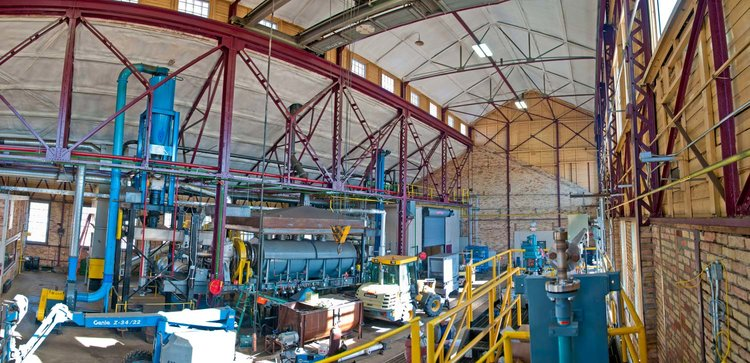 The Biofuel Conversion Center of the Natural Resources Research Institute is housed in the former railroad shops of the Oliver Iron Mining Company in Coleraine, Minnesota. Shown here is the main hall, which serves to house the large torrefaction reactor (center) that can create 14 tons of torrefied material per day. The boiler generator and additional torrefaction reactor will also be housed in this one-of-a-kind reserach facility.