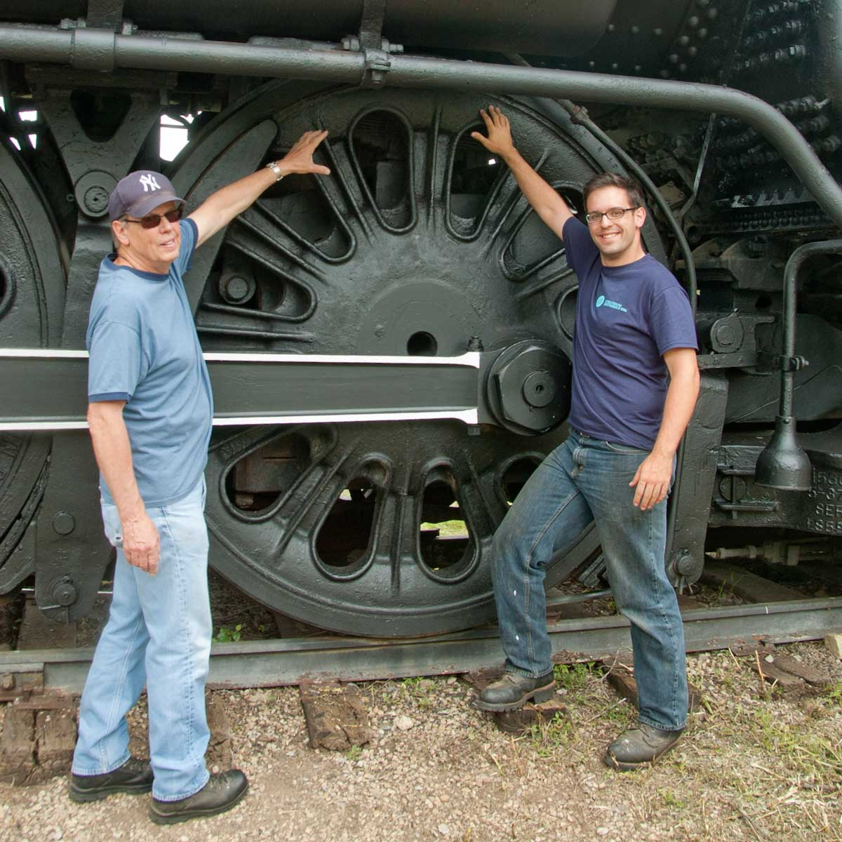 Scholl and CSR's President Davidson Ward beside the 84 inch drivers of ATSF 3463 in Topeka, Kansas.