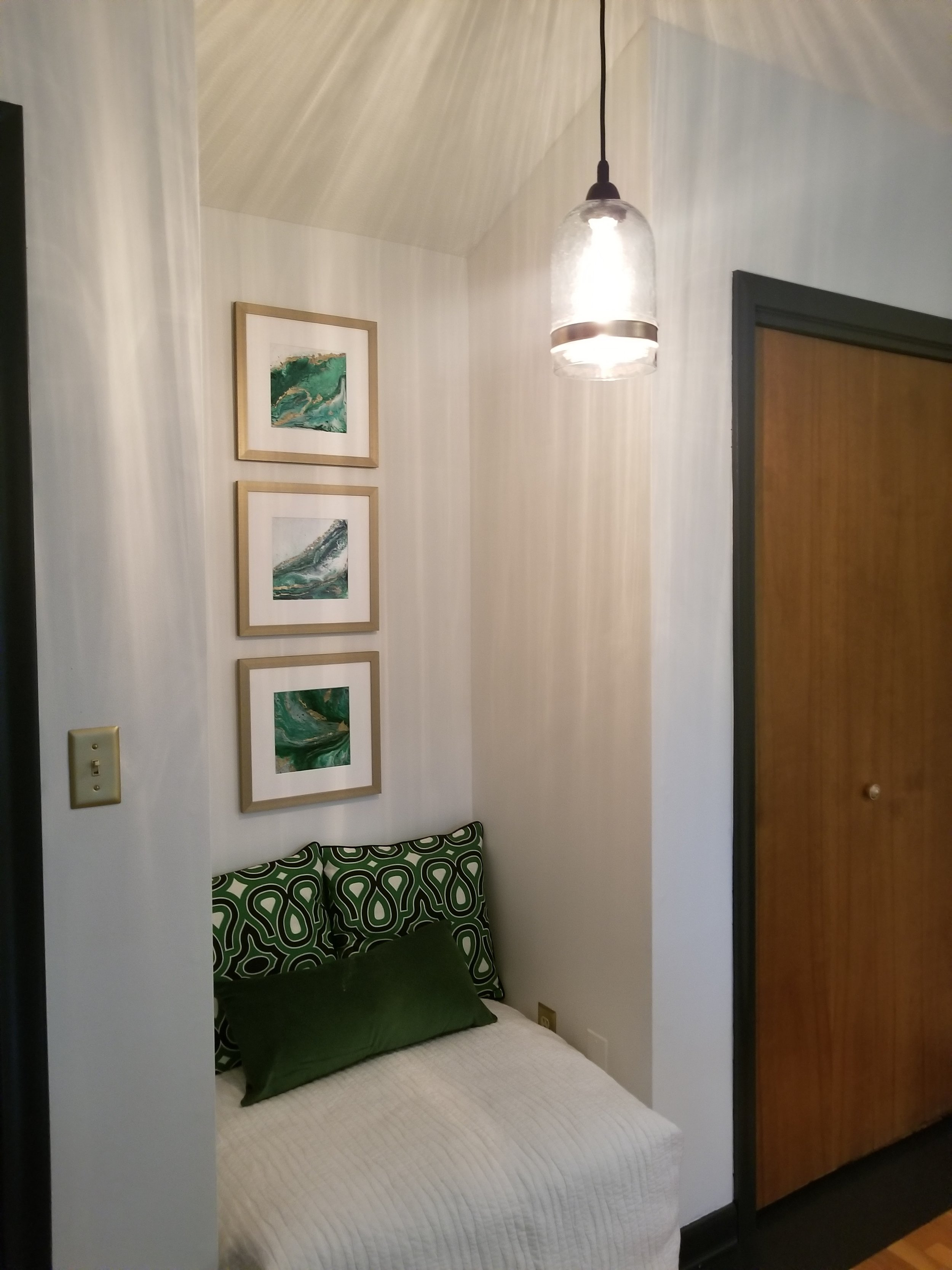 A cozy little nook, I had the green artwork previously in my dining room and it fits nicely in this space.