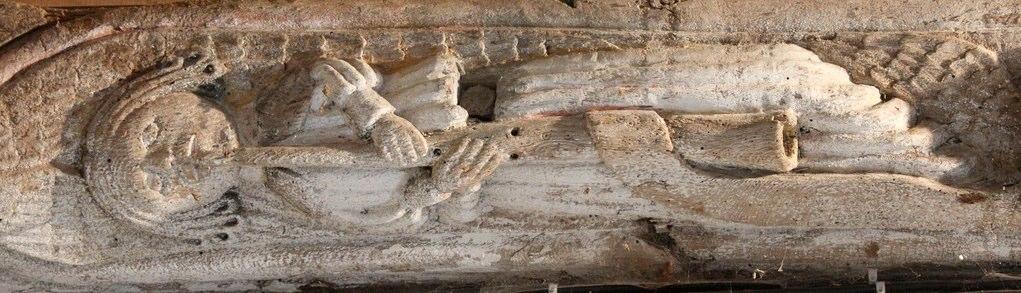 Sablière (horizontal, carved wooden element) in the church La Trinité, Cléguérec, Brittany.