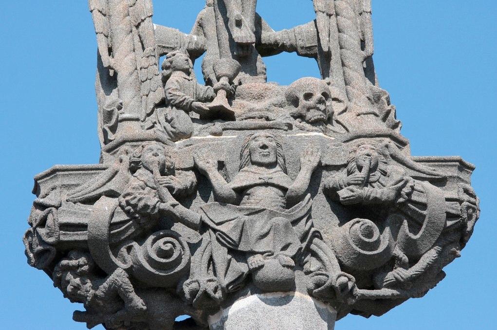 Cross on the main portal of L'enclos de la Martyre, Brittany.