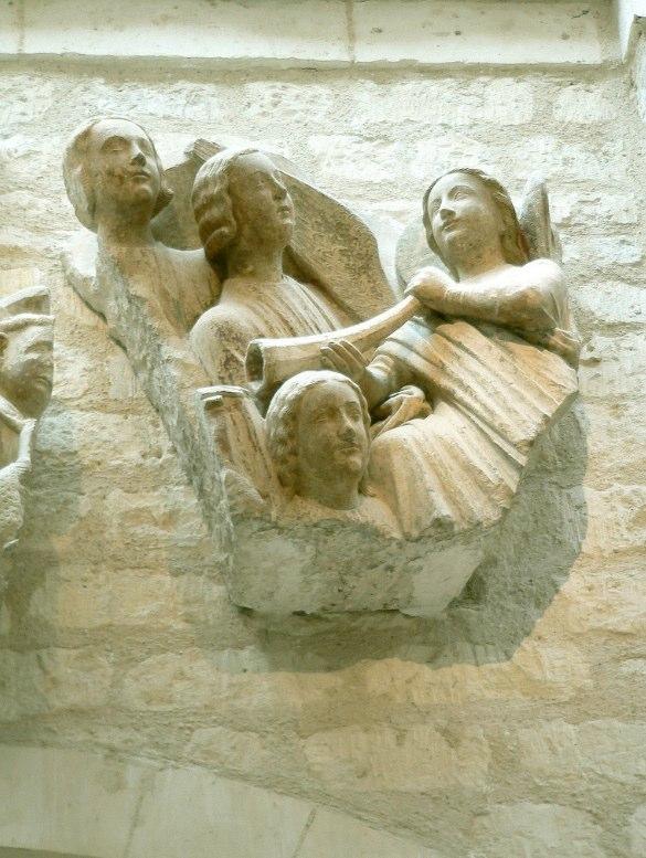 Relief of angel holding horn with facets, Cathedral of Notre Dame, Paris. Last judgement portal relief (original?). Musée de Cluny, Paris.