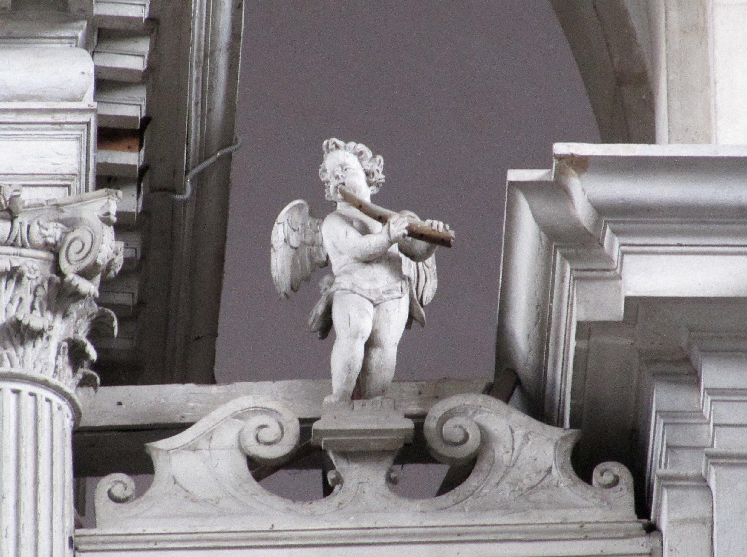 Venice, San Giorgio Maggiore; Angel cornettist on the case of the organ by Antonio Antegnati