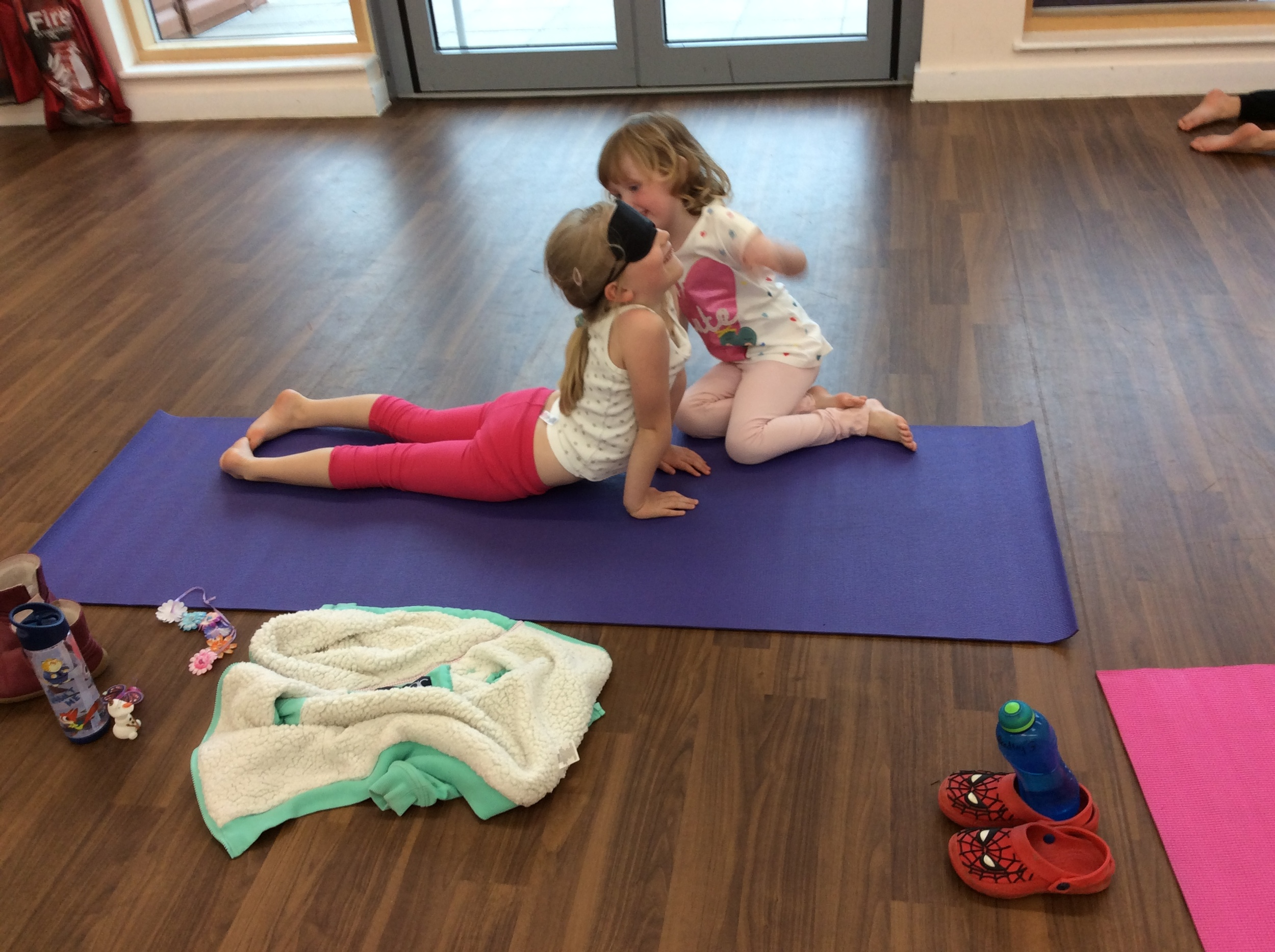 Wearing blindfolds in yoga has been challenging but very fun! We put a blind fold on, Melissa strikes a yoga pose and our partner has to describe the pose to us without telling us what it is!