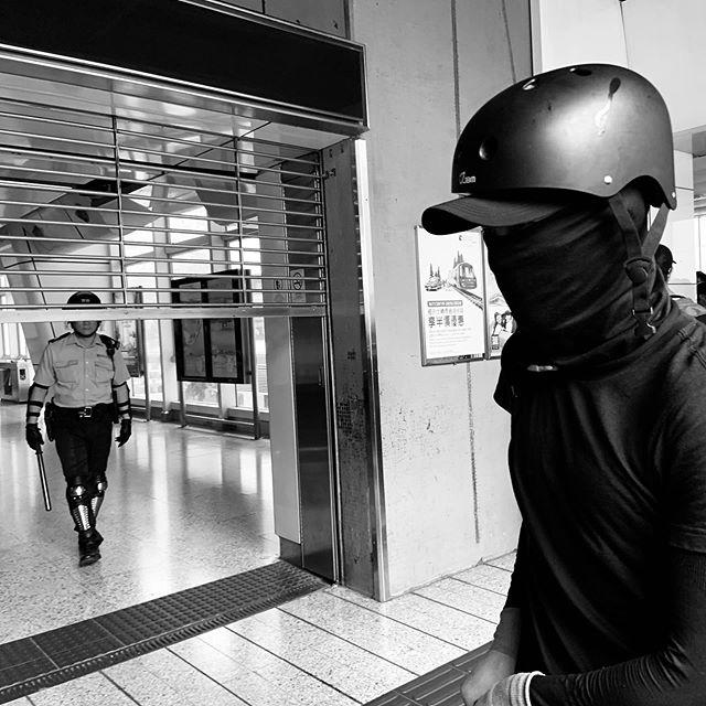#hongkong #kwuntong #hongkongprotest  #iphone.  A protestor moves in as the police arrive to safeguard the closed station.