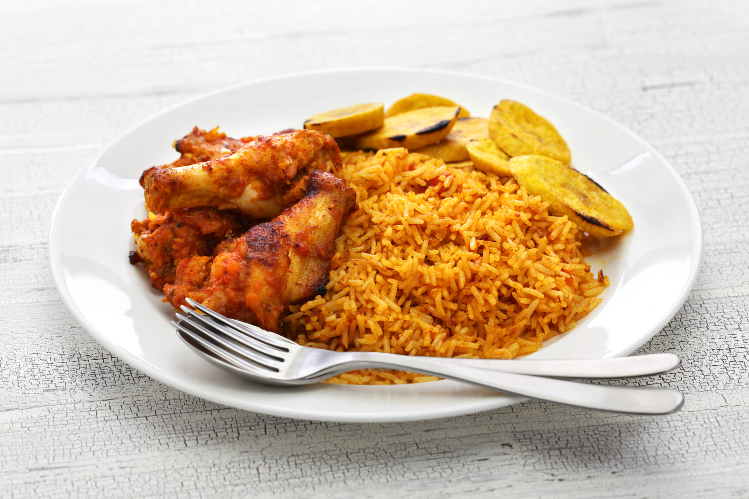 Jollof Rice Family Meal $39.99  Contains 1/2 a tray of Jollof Rice and 6 pieces of chicken.  Jollof rice is rice sautéed in blended tomatoes, onions, bell pepper and habanero  Pan size is 2 9/16 inches deep and 10 3/8 inches wide