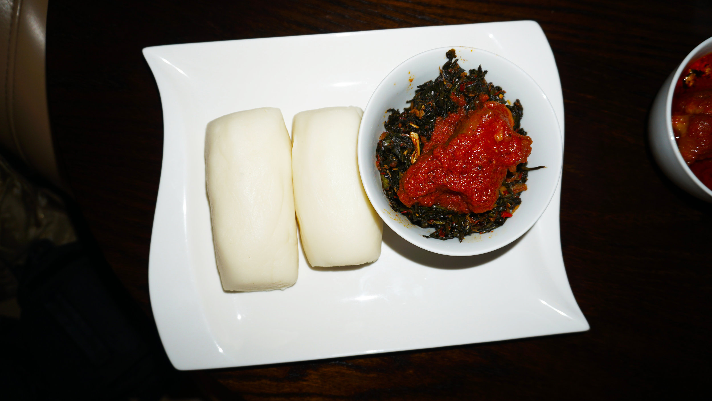 Spinach (Efo Riro) Sauce With Pounded Yam Family Meal $45.99  Large serving of spinach soup (Efo Riro), with 6 pieces of chicken and 8 wraps of pounded yam.  Spinach sauteed with tomato and assorted pepper blends. Garnished with assorted meats.  Bowl Size is 2 inches deep and 9 inches wide