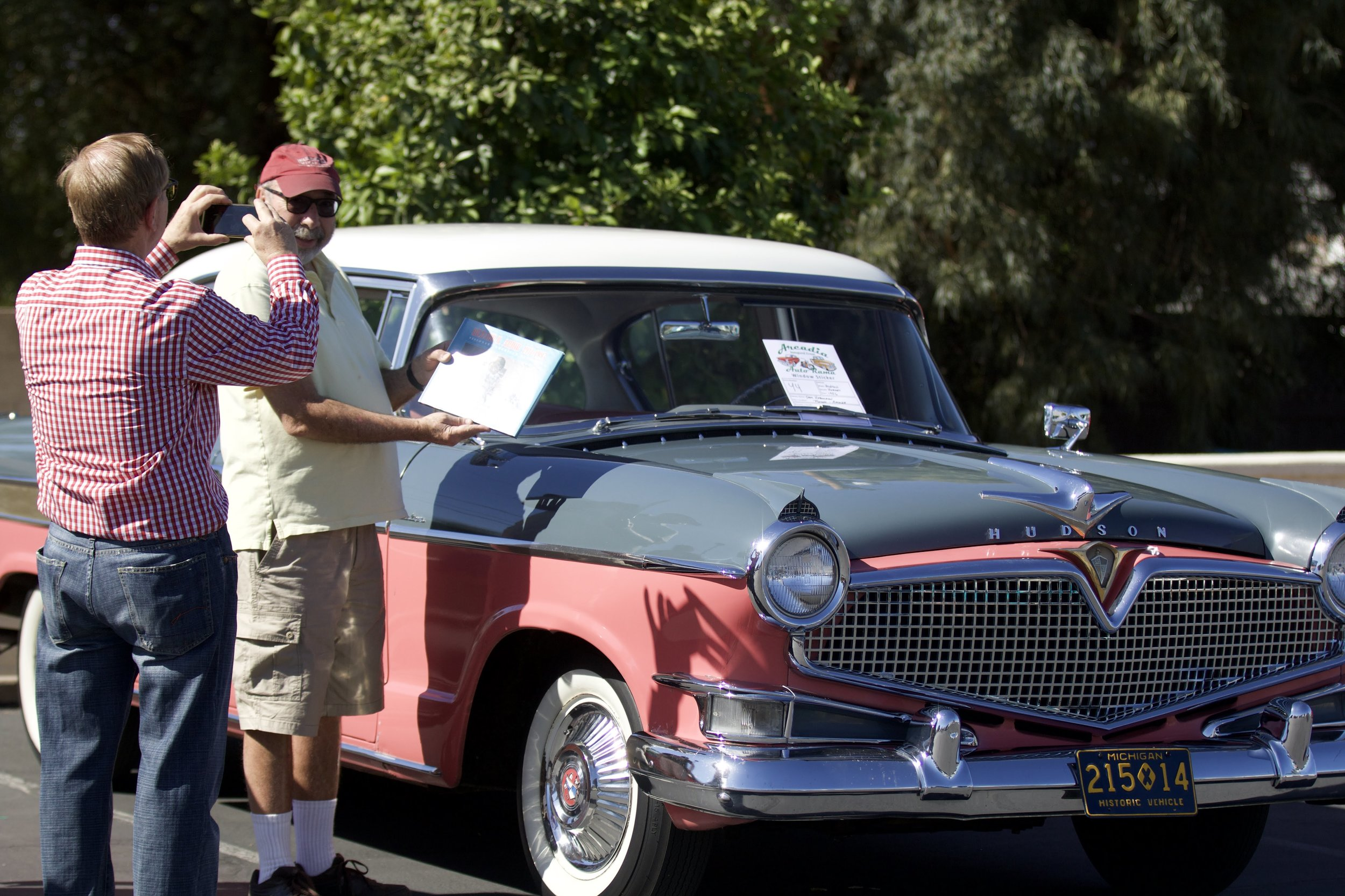 Sam Haberman and his 1956 Hudson Hornet. Gerrit Steenblik, Founding President of ACMNA is taking the picture