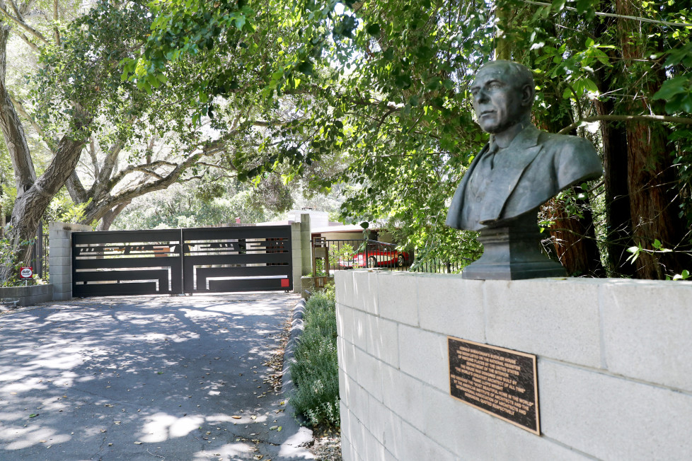 A plaque and a bust is seen outside the Frank Lloyd Wright estate house owned by Gerald Shmavonian where neighbors complain for hosting weddings and other social events at the house on Great Oak Circle in Orinda, Calif., on Tuesday, July 17, 2018. The Orinda city zoning ordinance prohibits commercial events in a residential neighborhood.(Ray Chavez/Bay Area News Group)