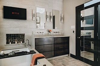 Happy Tuesday! Who could use a nice bath and Netflix? Here's one of our favorite Master Bathroom renovations  #interiordesign #bathroomdecor #bathroomremodel