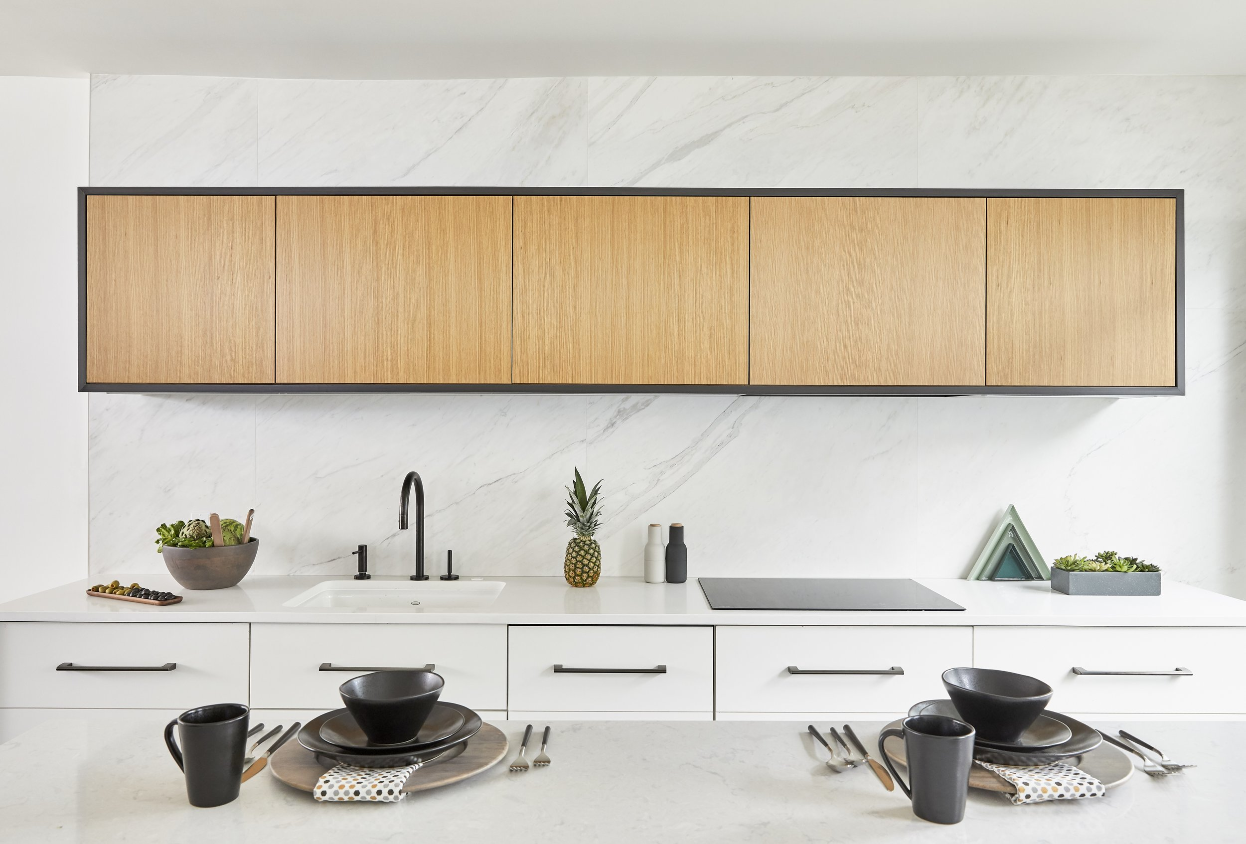 "PURO   Inspired by Scandinavian and German design, this modern kitchen is decidedly fuss-free and ""pure"". The surfaces and materials focus on the use of neutral materials and earthy colors while eliminating unnecessary detailing."