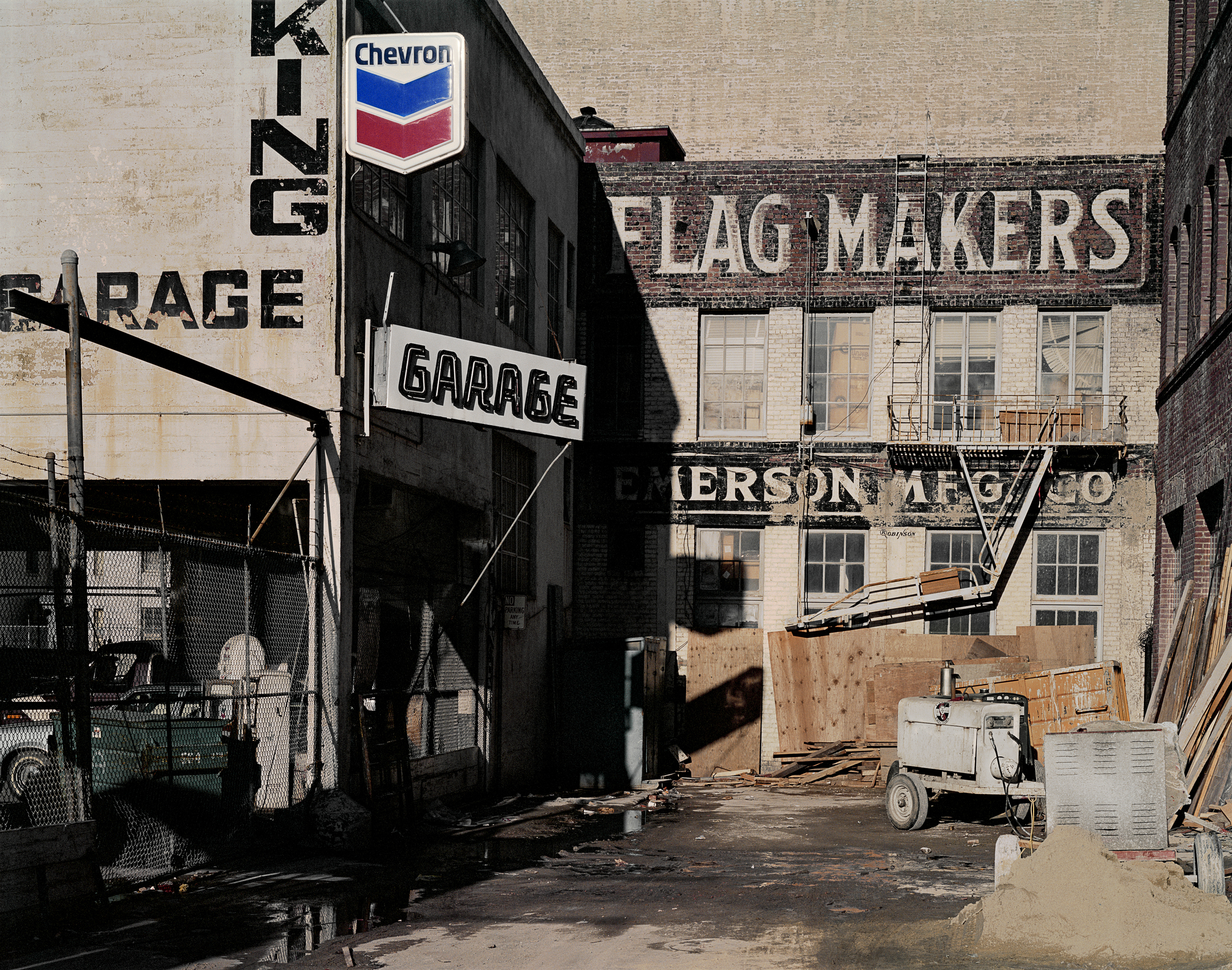 JANET DELANEY Flag Makers, Natoma at 3rd Street, 1982 Archival Pigment Print, 2016 16 x 20 inches, edition of 5 20 x 24 inches, edition of 2 30 x 40 inches, edition of 2