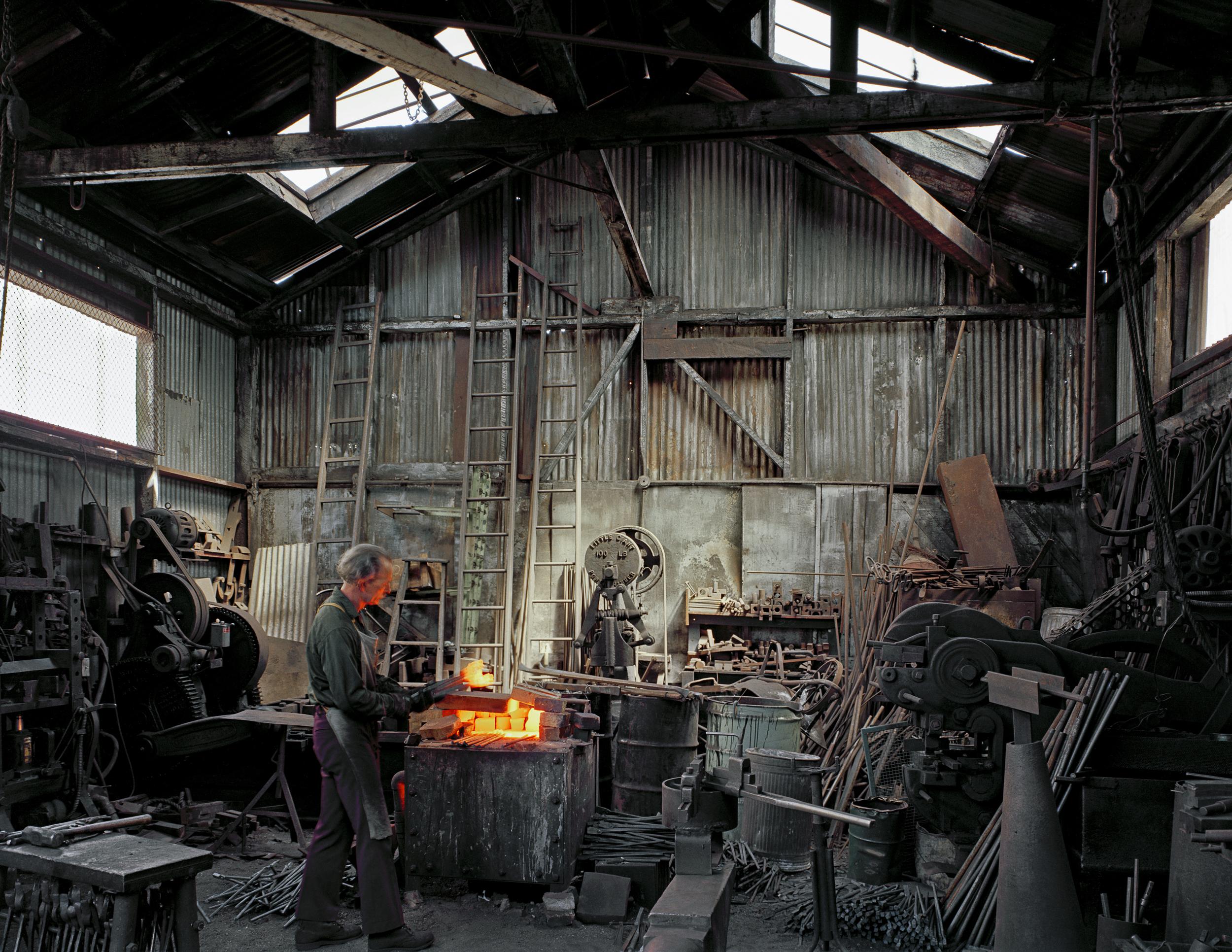 JANET DELANEY Johnny Ryan, Blacksmith, Klockars Blacksmith and Metal Works, 443 Folsom Street, 1980 Archival Pigment Print, 2016 16 x 20 inches, edition of 5 20 x 24 inches, edition of 2 30 x 40 inches, edition of 2