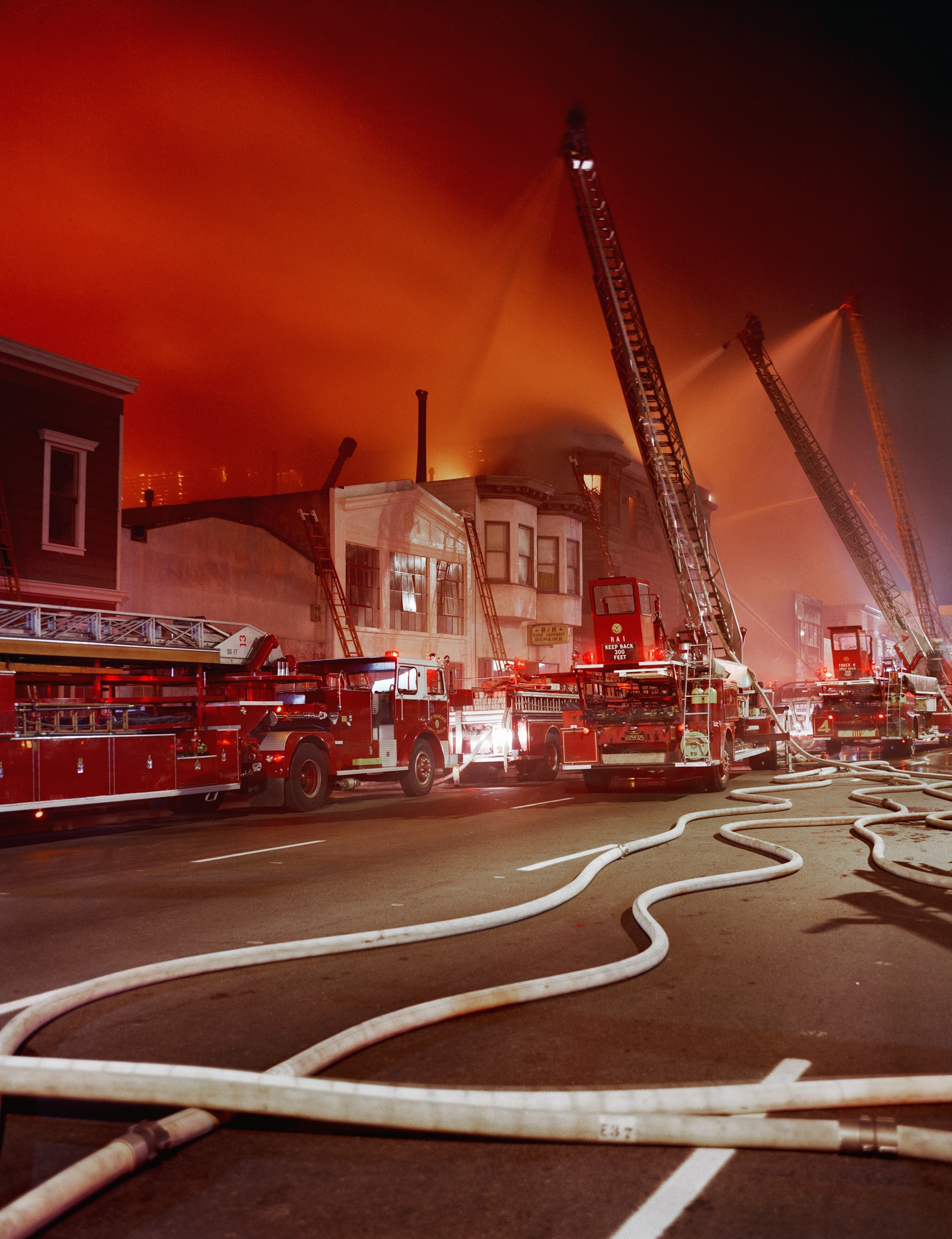 JANET DELANEY Fire Captain Andy Casper being interviewed after the July 10th five-alarm fire on Folsom Street, 1981 Archival Pigment Print, 2016 16 x 20 inches, edition of 5 20 x 24 inches, edition of 2 30 x 40 inches, edition of 2