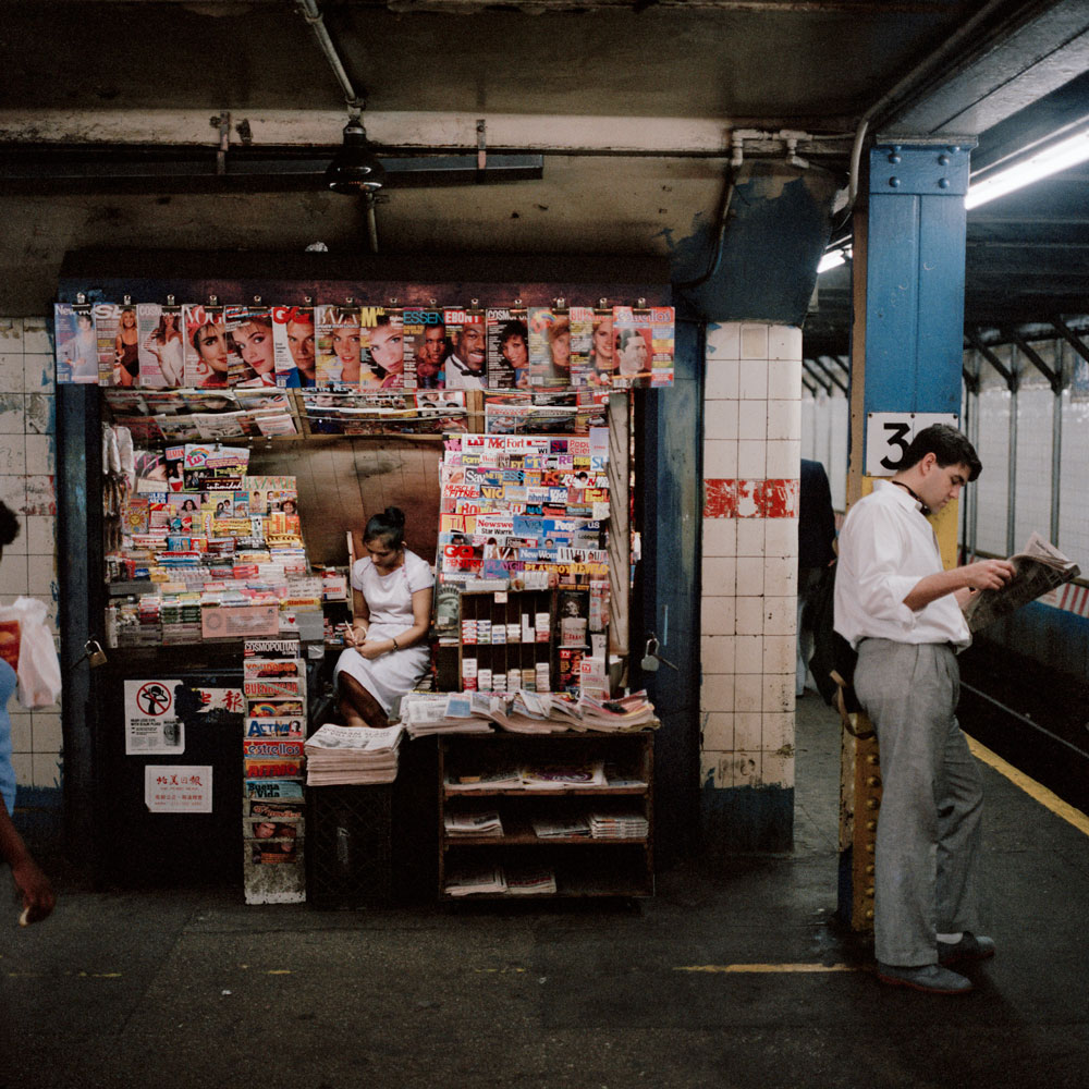 JANET DELANEY Newsstand in the Subway, 1985 from New York City 1984-1987 Archival Pigment Print 15 x 15 inches, edition of 5 24 x 24 inches, edition of 2