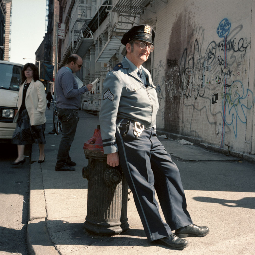 JANET DELANEY Policeman, SoHo, 1986 from New York City 1984-1987 Archival Pigment Print 15 x 15 inches, edition of 5 24 x 24 inches, edition of 2