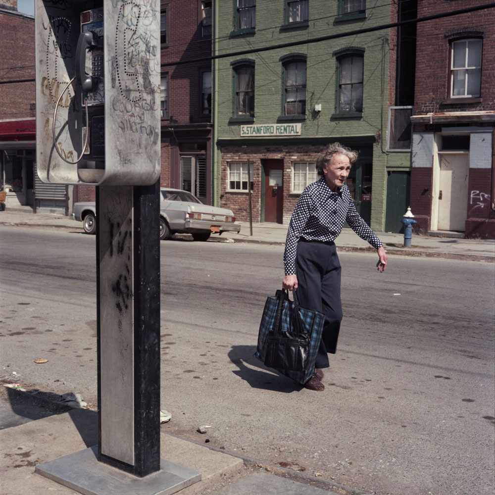 JANET DELANEY Woman Walking on the Street, 1986 from New York City 1984-1987 Archival Pigment Print 15 x 15 inches, Edition of 5 24 x 24 inches, Edition of 2
