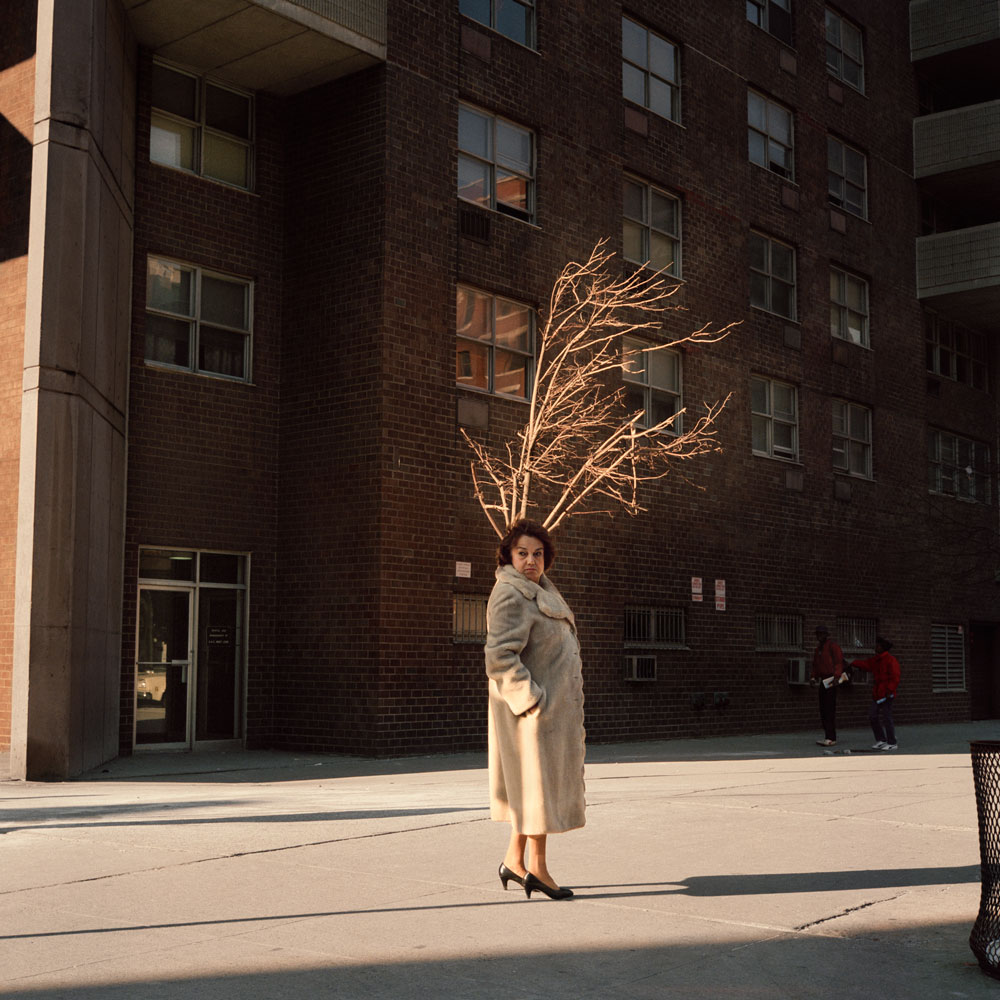 JANET DELANEY Woman with Tree, 1987 from New York City 1984-1987 Archival Pigment Print 15 x 15 inches, edition of 5 24 x 24 inches, edition of 2