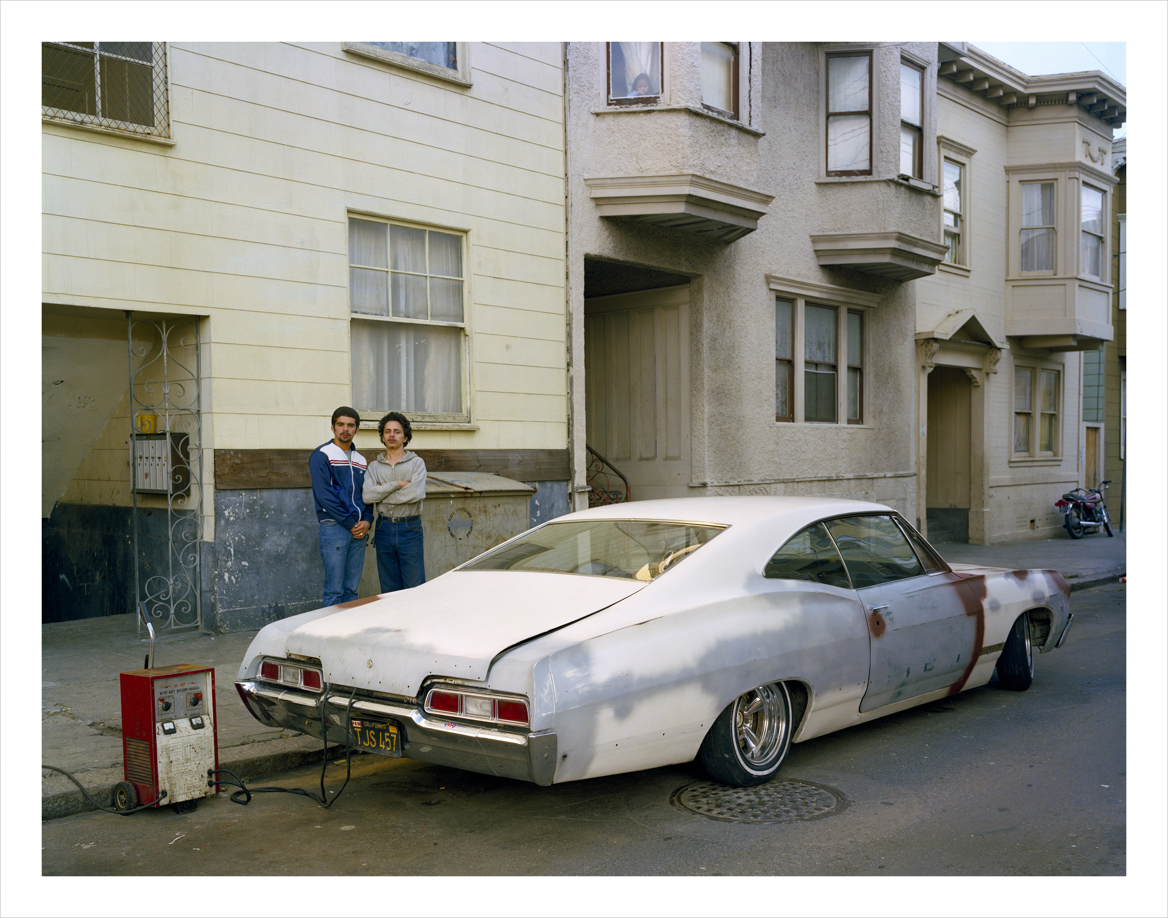 JANET DELANEY Charging battery, Moss Street, 1982 Archival Pigment Print, 2016 16 x 20 inches, edition of 5 20 x 24 inches, edition of 2 30 x 40 inches, edition of 2