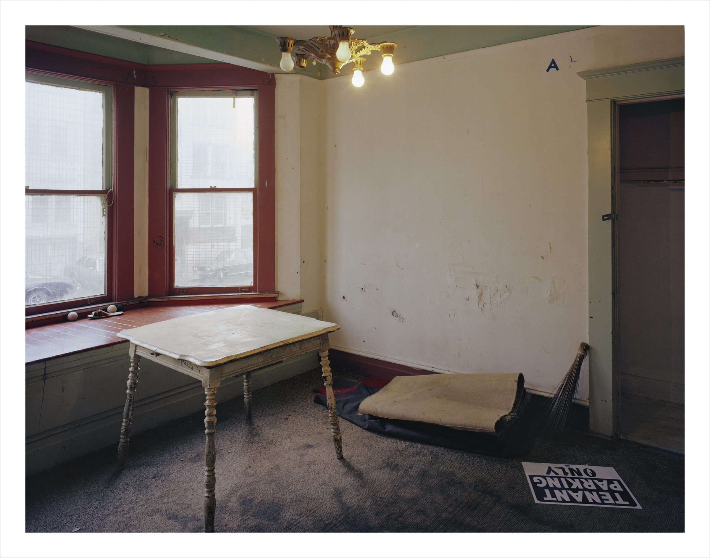 Front Parlor of one of six apartments from which 90 Filipinos were recently evicted, Russ Street, 1980 Archival Pigment Print, 2016 16 x 20 inches, edition of 5 20 x 24 inches, edition of 2 30 x 40 inches, edition of 2