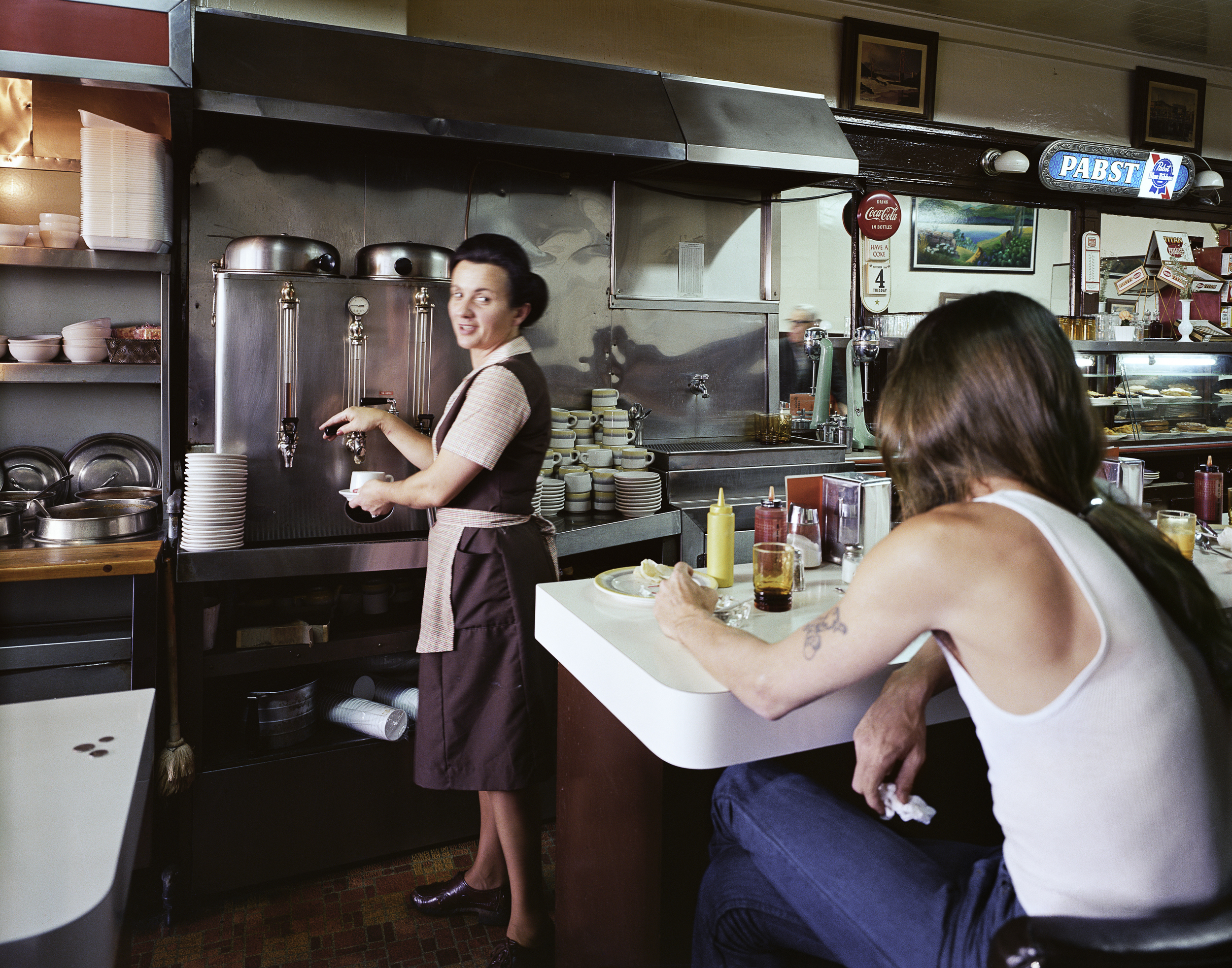 Pat serving coffee at the Gordon Cafe, 7th at Mission Street, 1980 Archival Pigment Print, 2016 16 x 20 inches, edition of 5 20 x 24 inches, edition of 2 30 x 40 inches, edition of 2