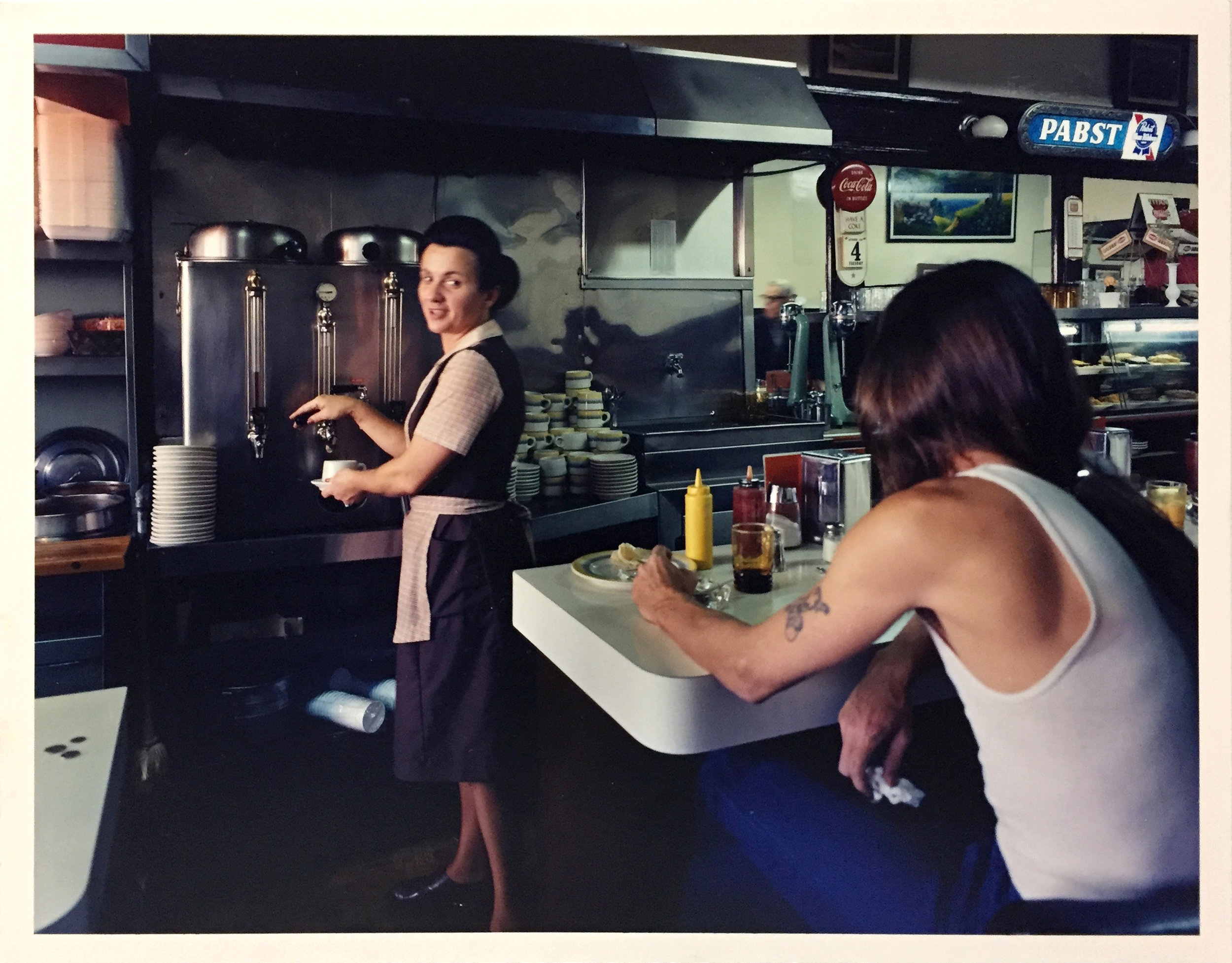 Pat serving coffee at the Budget Hotel, 7th at Mission Street, 1980 Vintage Chromogenic Print 11 x 14 inches and 16 x 20 inches