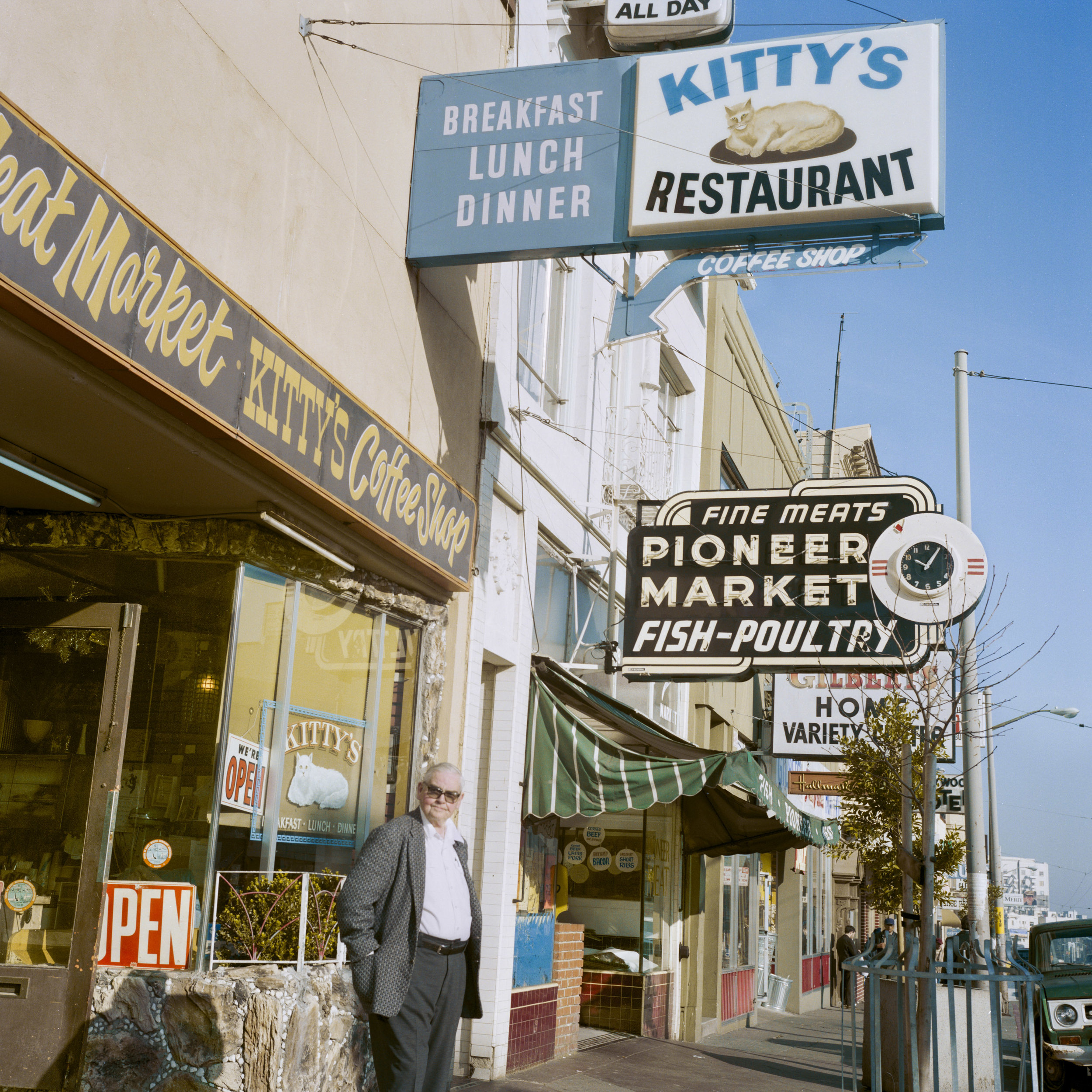 JANET DELANEY  Kitty's Coffee Shop, Mission Street, 1984  from  Public Matters  Archival Pigment Print, 2018  Available in 2 sizes 9 x 9 inches, edition of 7 + 2AP 15 x 15 inches, edition of 3 + 2AP