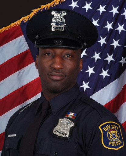 Officer Brandon Murphy;  Photo: via mlive.com