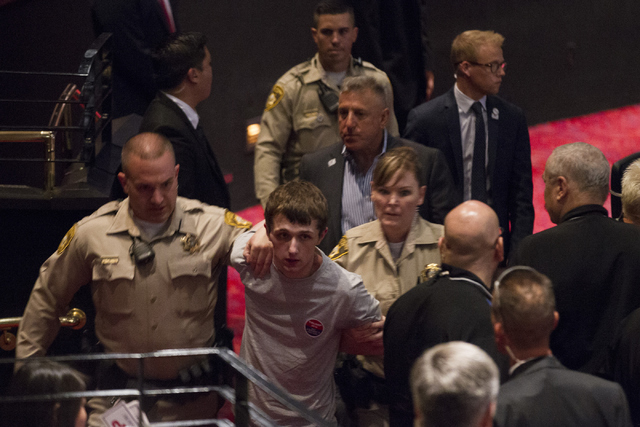 Protester arrested at Trump rally in Vegas;  Photo:Erik Verduzco/Las Vegas Review-Journal