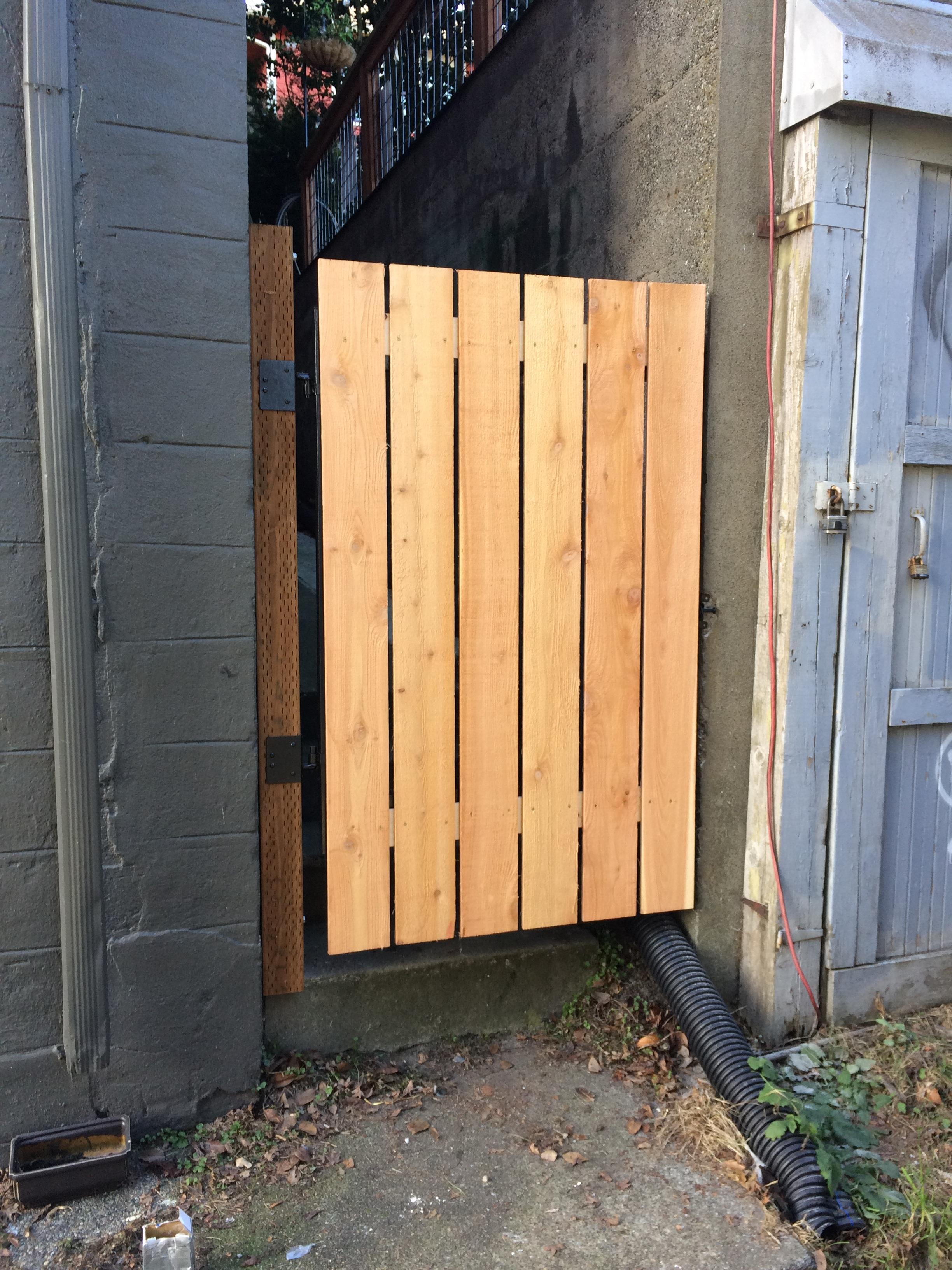 New gate installed in alleyway