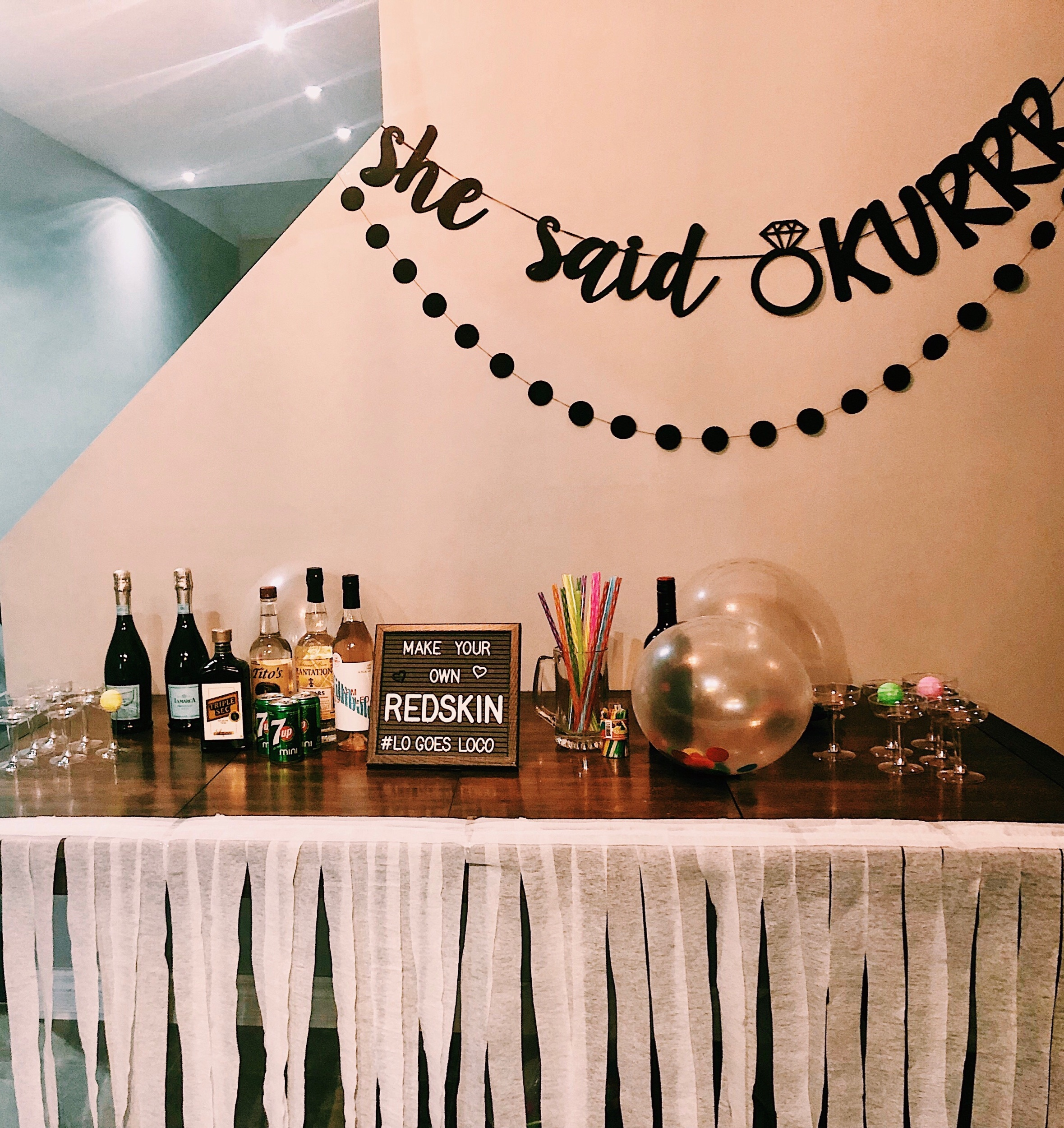 Prosecco pong and a Cardi B engagement banner!