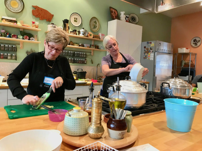 Lynn Peterson, left, and Kim Mahan take part in a dim sum class at Class Cooking. Photos by Rachel Pinsky