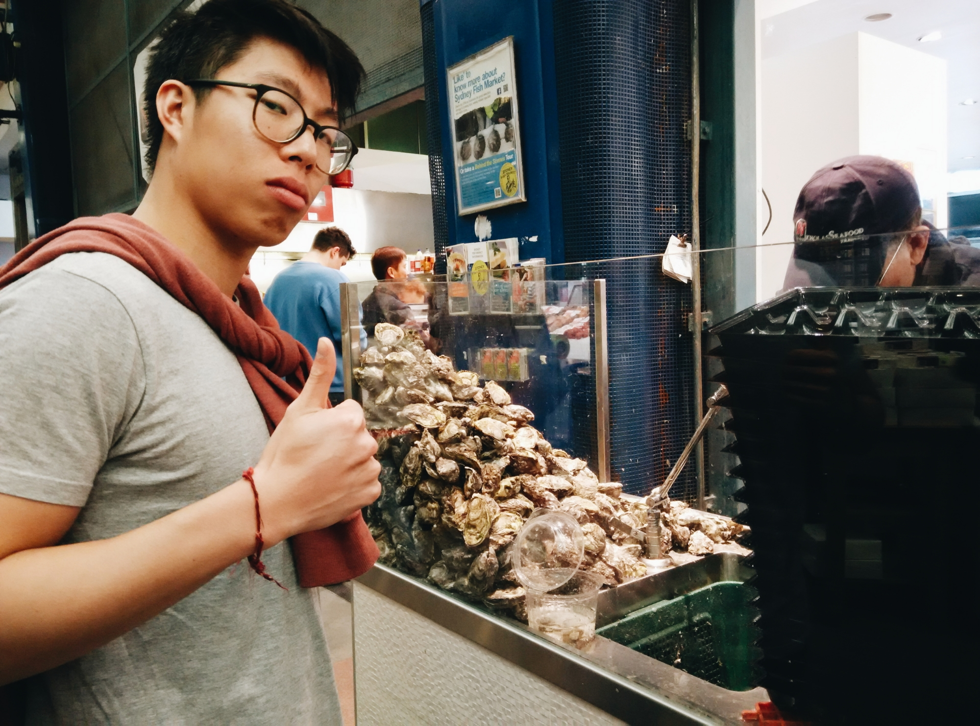 Watching the oysters get shucked and ready!