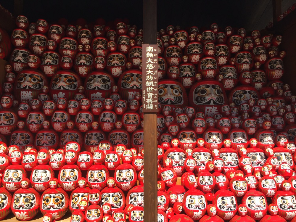 Dozens of daruma dolls returned to the temple after wishes have come true.