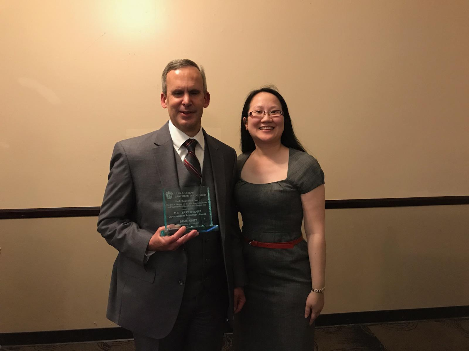 Brian Unitt, recipient of the 2018-2019 Terry Bridges Outstanding Attorney Award, and L. Alexandra Fong, President of the Leo A. Deegan Inn of Court.