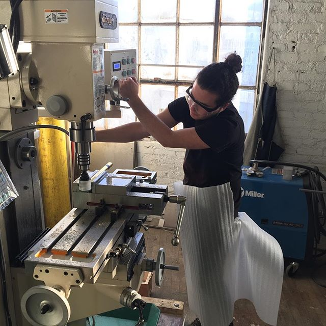 Shi using our new mill while sporting our new apron design. More to follow.