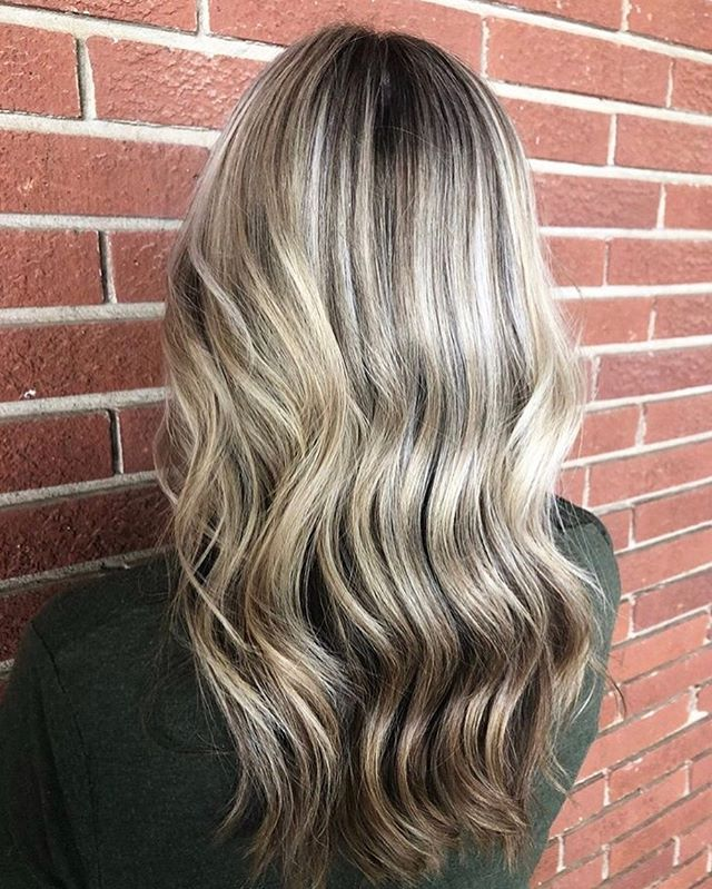 """Highlights are a great way to transition to embracing """"mother nature's highlights"""" don't you think? ⠀ A partial highlight allows some more darkness and dimension to come through the hair than a full highlight. ⠀ Book for either with any of our stylists to brighten up, blend in, or grow out your hair color ⠀ ⠀ Color by @haylienhair⠀"""