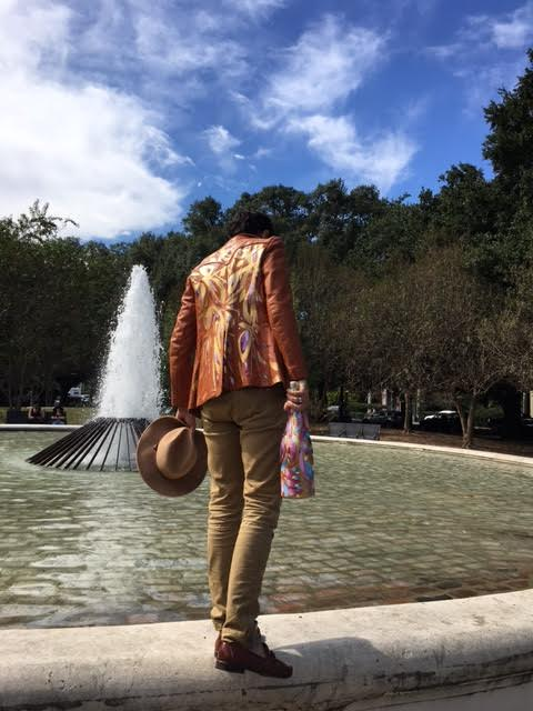 Collin is rocking a hand painted leather jacket (price upon request), fitted khakis he scored at Buffalo Exchange, a hat from  Meyer the Hatter  and his favorite Cole Haan loafers with woven detail and cross strap. He's hefting a custom  Veuve magnum , which can be had for $650.