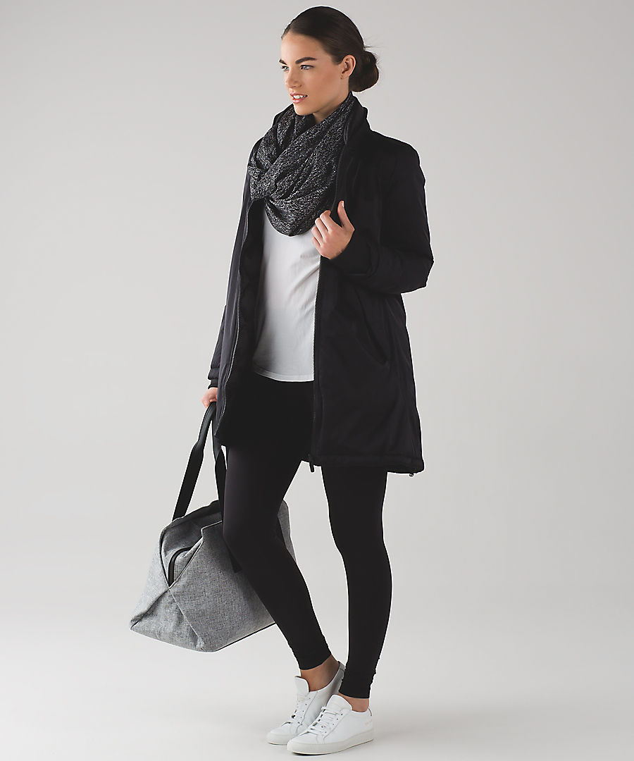 Lululemon's signature look, featuring a $58.00 wrap scarf, $98 yoga pants, with coordinating bag and shirt.