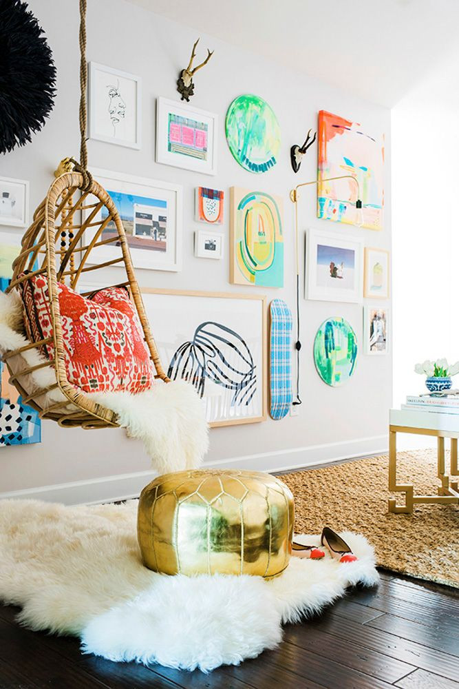 3-D gallery wall featuring an eclectic mix of art and objects