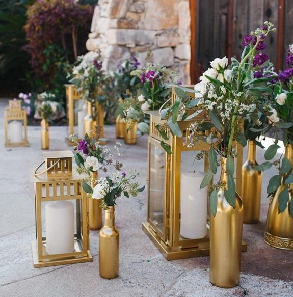 gold-lanterns-and-spray-painted-bottles-wedding-aisle.jpg